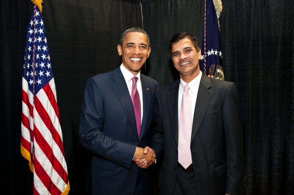President Barack Obama shaking hands with Sridhar Kota