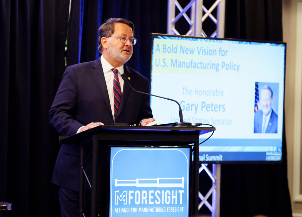 Senator Gary Peters at podium, talking about a bold new vision for U.S. manufacturing policy.